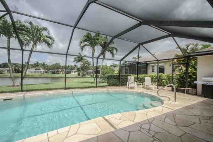 Private heated swimming pool awaits in this well manicured vacation oasis! - Briarwood 4BR/3BA Single Story Pool Home w/2 Car Garage & Incredible Lake Views - Naples - rentals