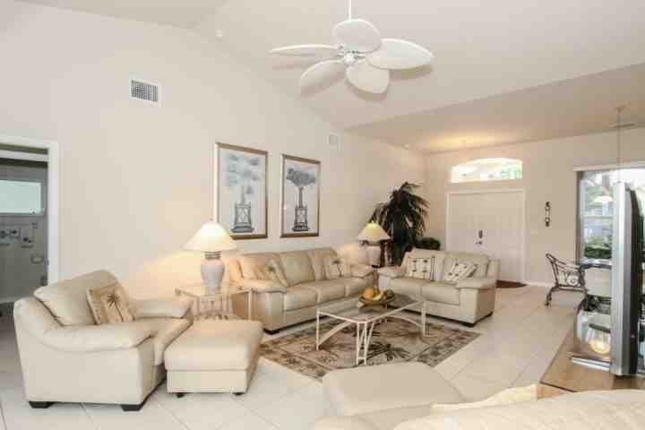 Tastefully decorated living room with comfortable seating. - Briarwood, 4 BR/3 BA, Single Story Pool Home w/2 Car Garage & Amazing Lake Views! - Naples - rentals