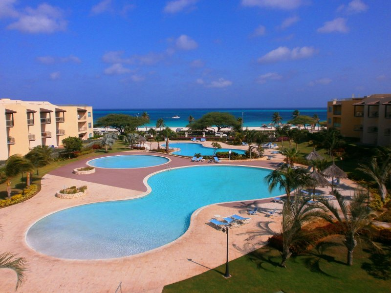 This is your supreme ocean and pool view from your balcony! - Supreme View Two-bedroom condo - A344 - Eagle Beach - rentals
