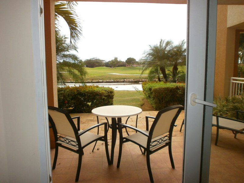 Enjoy your coffee or cocktails on your patio - Divi Golf Garden Studio condo - DR02 - Palm/Eagle Beach - rentals