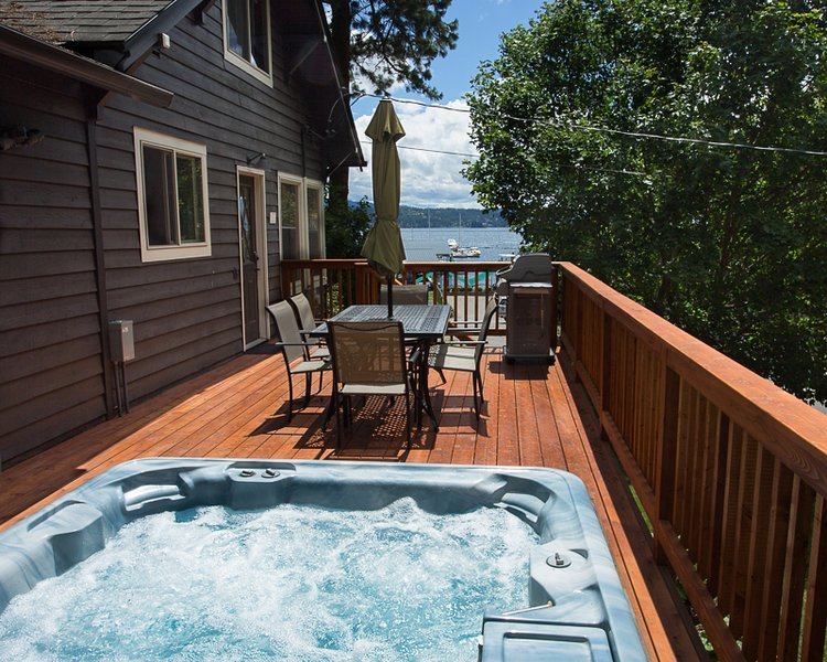 Hot tub, family seating and barbecue overlooking the lake all on a brand new deck! - Downtown Cottage with Lake & Park Views w/ Hot Tub - Coeur d'Alene - rentals