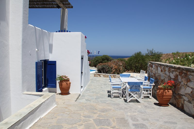 Outdoor dining area for your exclusive use - Two Bedroom Apartment by the Sea - Parasporos - rentals