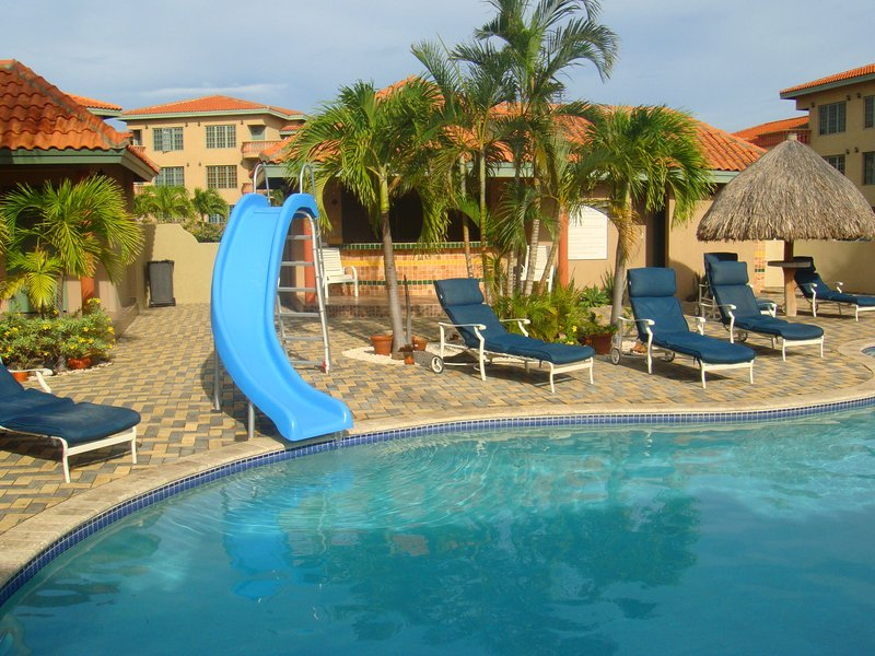 Palma Real's swimming pool at clubhouse. - Palm Comfort Two-bedroom condo - PR045 - Palm Beach - rentals