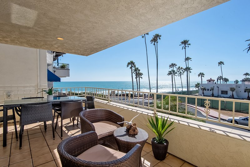 Ocean view balcony includes a dining table for 6, a grill, and additional outdoor seating to enjoy the ocean air! - Ocean Views, Steps to beach access at North Beach, San Clemente. - San Clemente - rentals