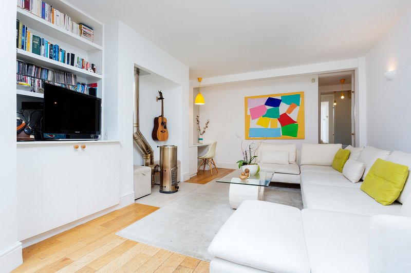 Bright three-bedroom Victorian flat with  private patio and garden, moments from Hampstead Heath. - Image 1 - London - rentals