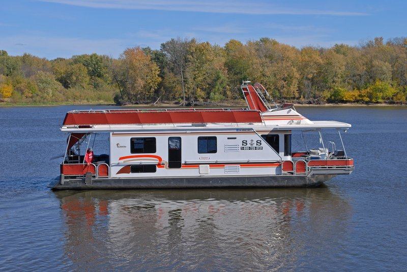 One of our houseboats on the river - S&S Houseboats - Lansing - rentals