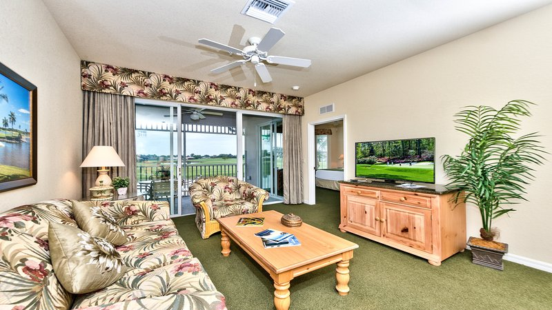 Living Room with Flat Screen TV, Fan, and Entrance to Lanai Area with Lake and Golf Views; Couch is a Pull Out! - Messina 2nd Floor Golf Condo at the Lely Resort - Naples - rentals