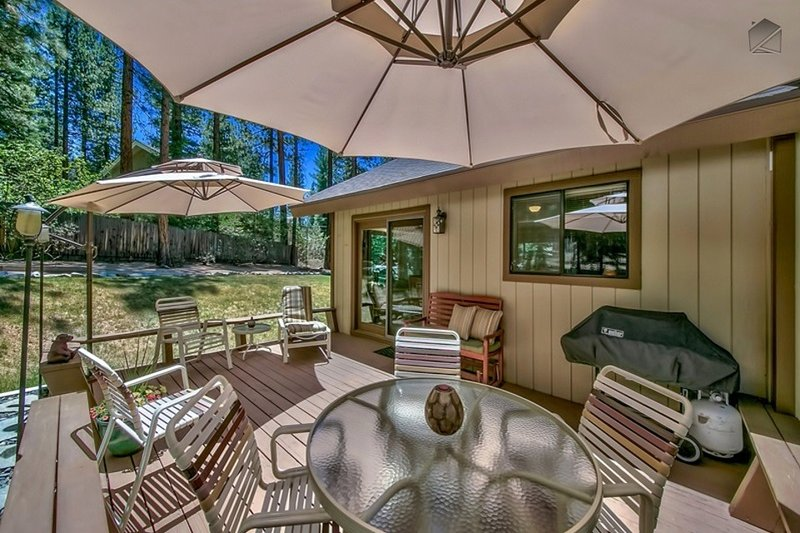 Make camp for the day on your spacious deck, complete with plenty of patio seating and grill. - Spacious home in Montgomery Estates with horseshoes, grill, outdoor patio - Peaceful Pines - South Lake Tahoe - rentals