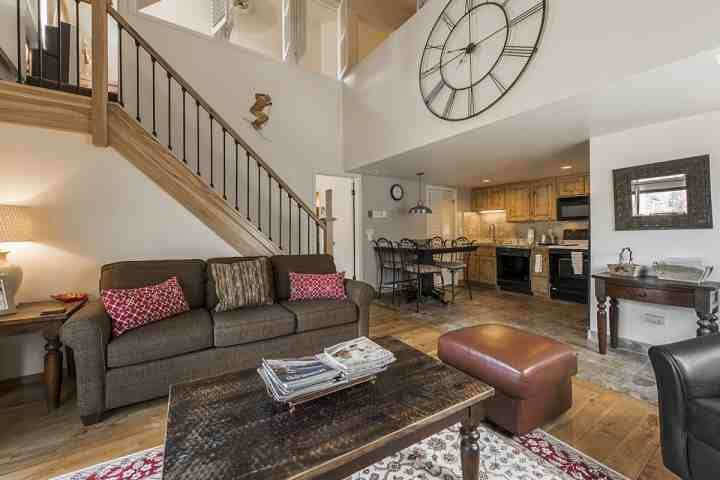 The living area is fully furnished with a  sofa, end tables, fireplace with hardwood detailing & a HDTV with satellite. - Red Pine Falcon View - Park City - rentals