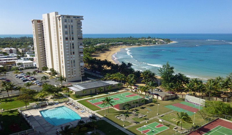 Fantastic view from balcony shows facilities and direct beach access. - Tropical Paradise in Our Playa AzulCondo Apartment - Luquillo - rentals