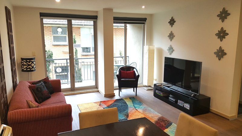 """Catani 2 Living area - now with 60"""" UHD Smart TV - StayCentral Catani 2 quiet beach trams restaurants - St Kilda - rentals"""