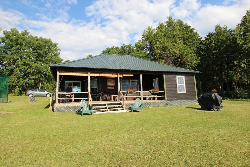 Picture-perfect lakefront cottage w/ a shared tennis court & dock! - Image 1 - Grand Isle - rentals