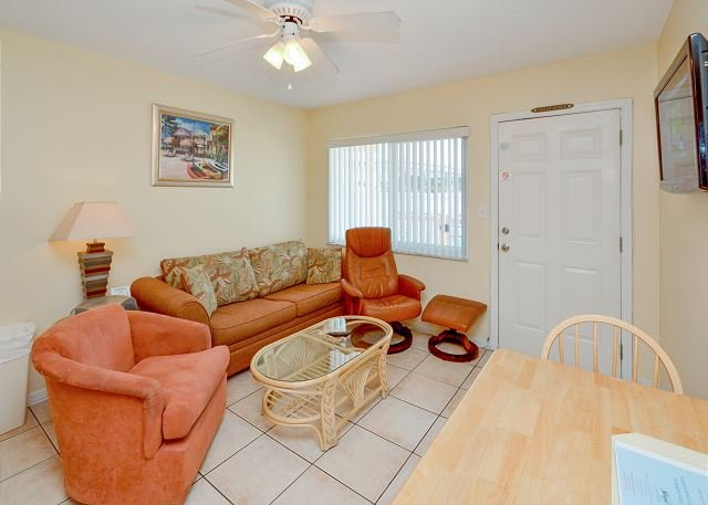 Living Room with sleeper sofa - Tropic Breezes #8 Nicely Updated Poolside Condo - Flatscreen TV and Free WiFi - Madeira Beach - rentals