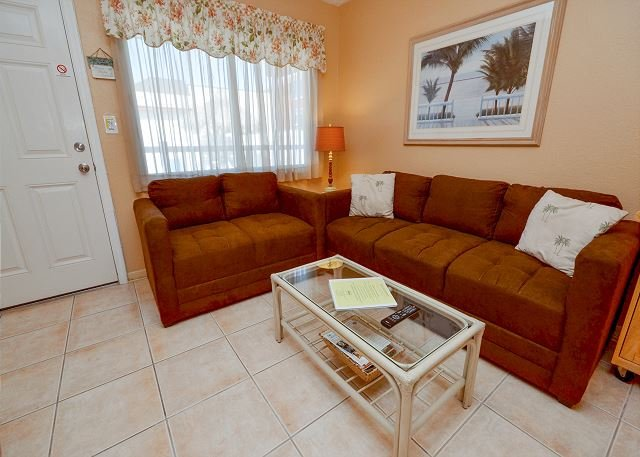 Living Room - Tropic Breezes #7 Beautiful Palm Tree Themed Poolside Condo with Smart TV's! - Madeira Beach - rentals