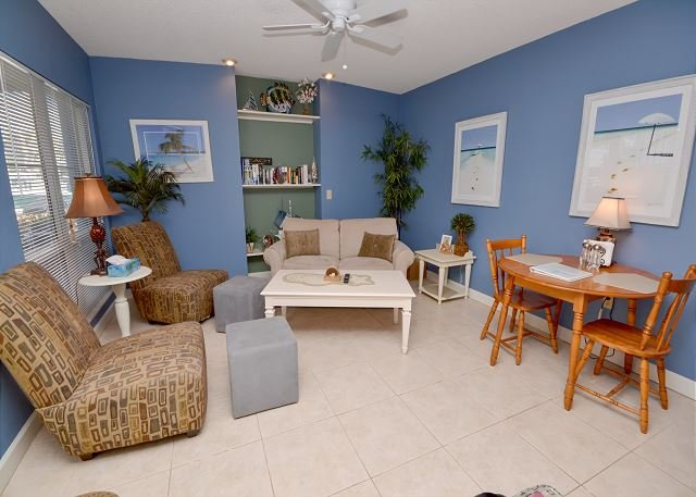 Living room with sleeper sofa - Madeira Beach Yacht Club 175-D- Remodeled Waterfront One BR Condo with Patio! - Madeira Beach - rentals
