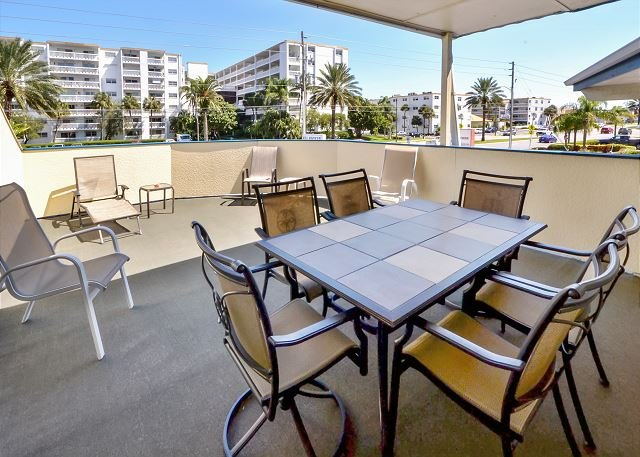 Patio with plenty of seating - Sea Rocket #15 - 2nd Floor w/ Private Deck and King Bed - Steps to the Beach! - North Redington Beach - rentals