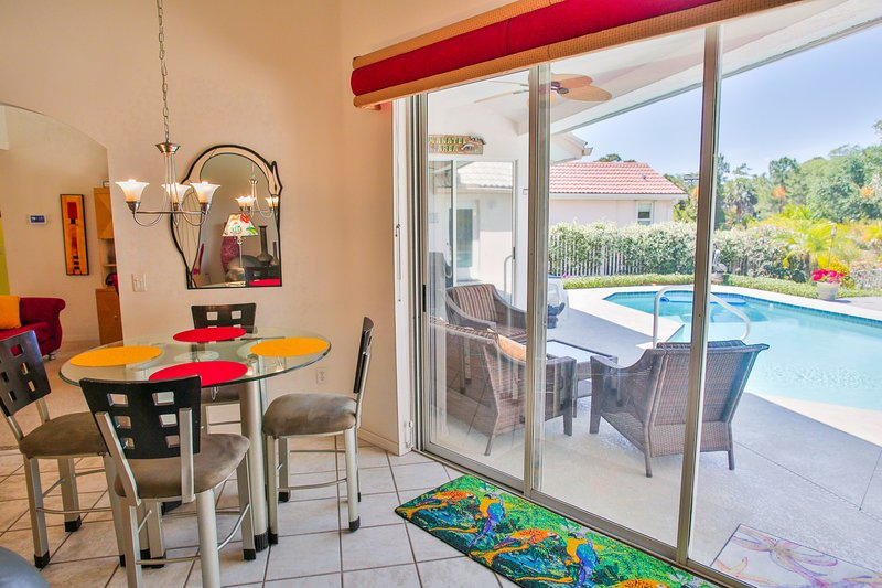 Dining area pool view - Tropical Island Retreat-Private Waterfront - Tarpon Springs - rentals
