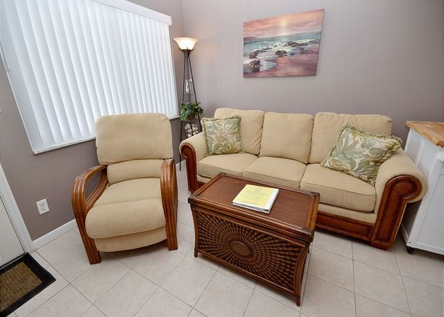 Living space with sleeper sofa - Tropic Breezes #12- 2nd Floor Gulf View Condo with Pool, BBQ and Free WiFi! - Madeira Beach - rentals