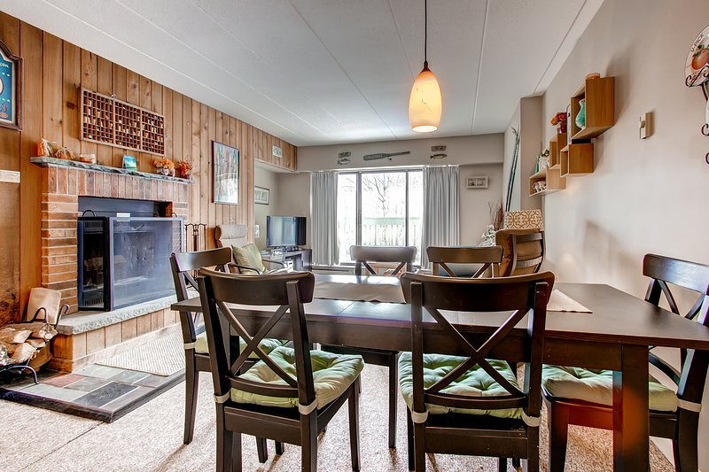 Looking through the dining area table into the living room w/ fireplace - Mt Green 1-D5 - Killington - rentals