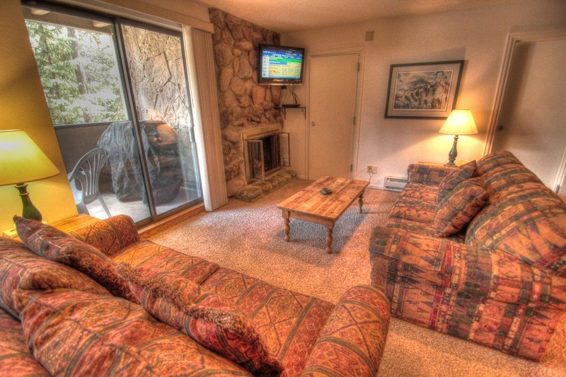 "SkyRun Property - ""CM216 Copper Mtn Inn"" - Living Room - The living room features a new flat screen TV with DVD player and a gas fireplace. - CM216 Copper Mtn Inn - Copper Mountain - rentals"