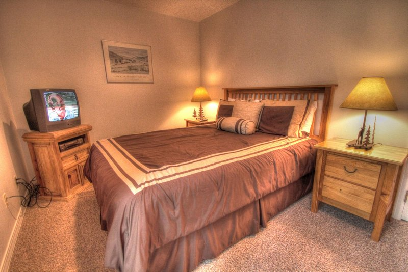 """SkyRun Property - """"CM212 Copper Mtn Inn Two Room Suite"""" - Master Bedroom - The master bedroom features a queen size bed and a TV. - CM212 Copper Mtn Inn Two Room Suite - Copper Mountain - rentals"""