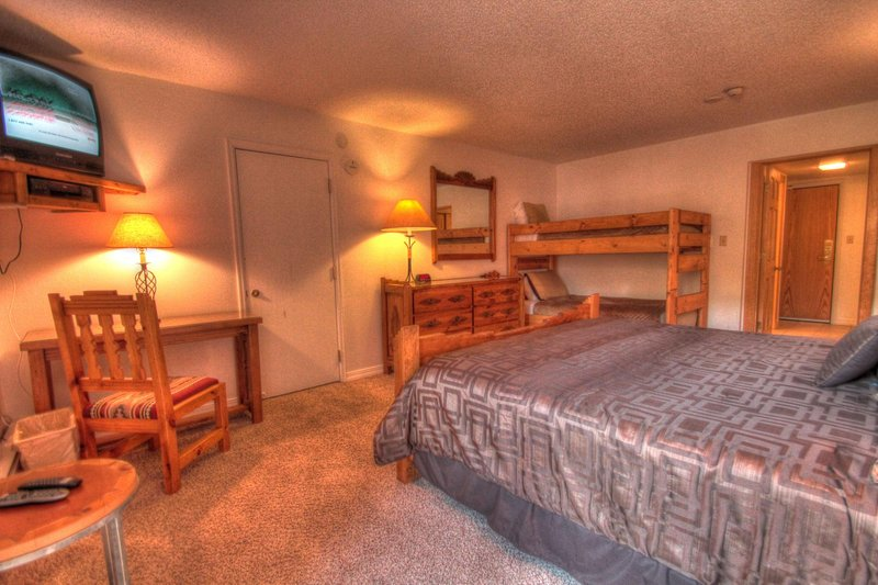 "SkyRun Property - ""CM217H Copper Mtn Inn"" - Hotel Room - This hotel room features a king size bed and a set of twin bunk beds. - CM217H Copper Mtn Inn - Copper Mountain - rentals"