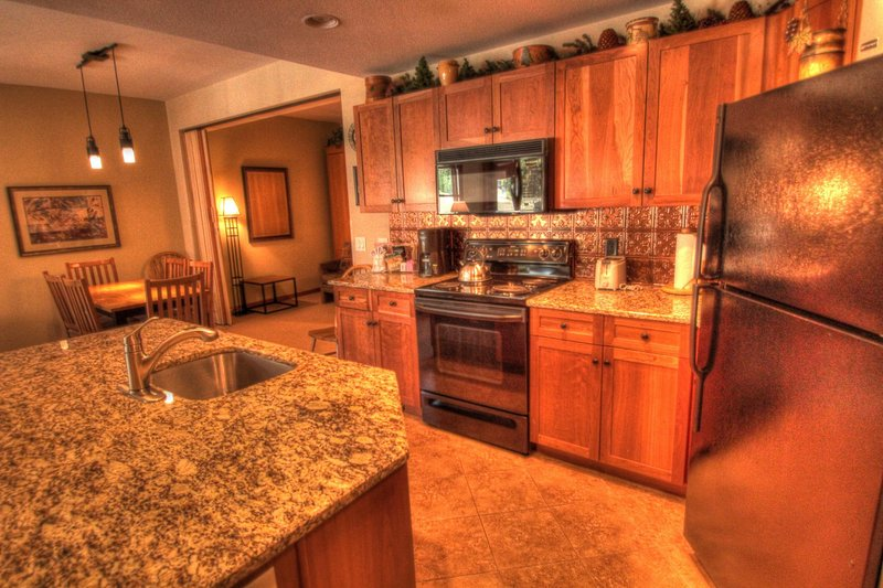 """SkyRun Property - """"CO422 Copper One Lodge"""" - Kitchen - The well appointed kitchen is newly remodeled and features granite counters and new appliances. - CO422 Copper One Lodge - Copper Mountain - rentals"""
