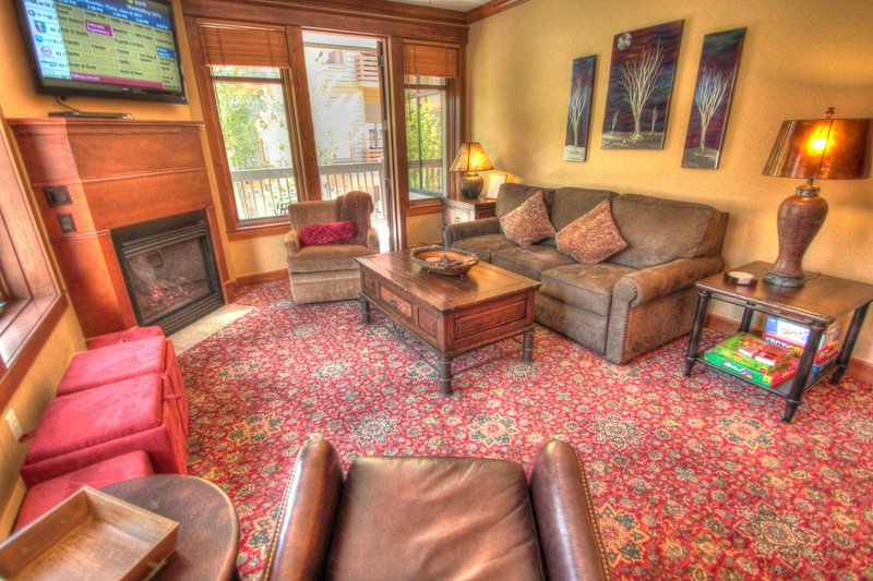 """SkyRun Property - """"MC204 Mill Club"""" - Living Room - Relax in front of the roaring gas fireplace or watch a movie on the new flat screen TV. - MC204 Mill Club - Copper Mountain - rentals"""