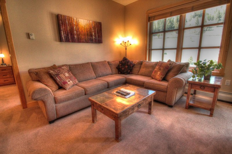 "SkyRun Property - ""PP502 Passage Point"" - Living Room - The newly redecorated living room has a fantastic sectional sofa. - PP502 Passage Point - Copper Mountain - rentals"