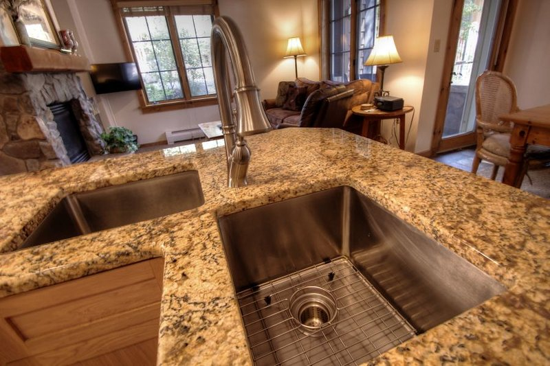 Kitchen - Kitchen features granite countertops and stainless steel appliances. - 8452 Dakota Lodge - River Run - Keystone - rentals