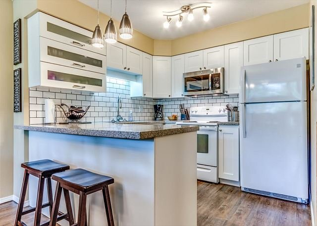 Renovated Kitchen - Acer Vacations | Family Friendly 2 Bedroom Ski-In Ski-Out Whistler Condo - Whistler - rentals