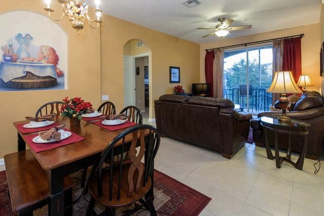 Comfortable leather sofas with queen sofa bed.  Dining room seating for 6. - Comfortable Luxury in Windsor Hills Resort - Orlando - rentals