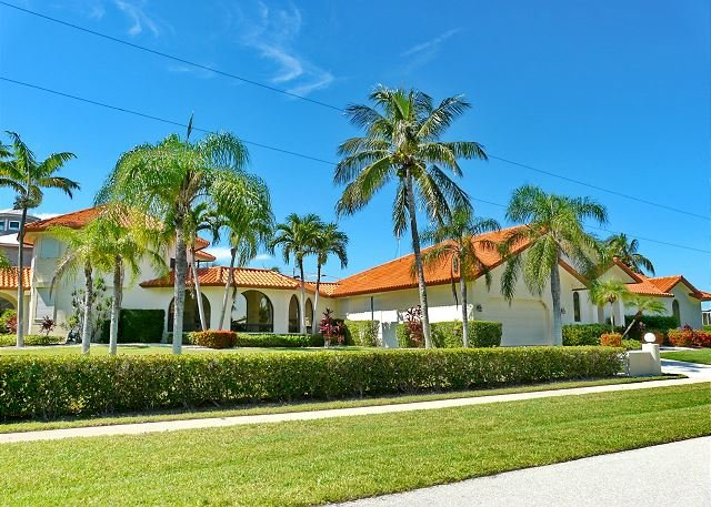 Unique waterfront house w/ heated pool, hot tub & separate guesthouse - Image 1 - Marco Island - rentals
