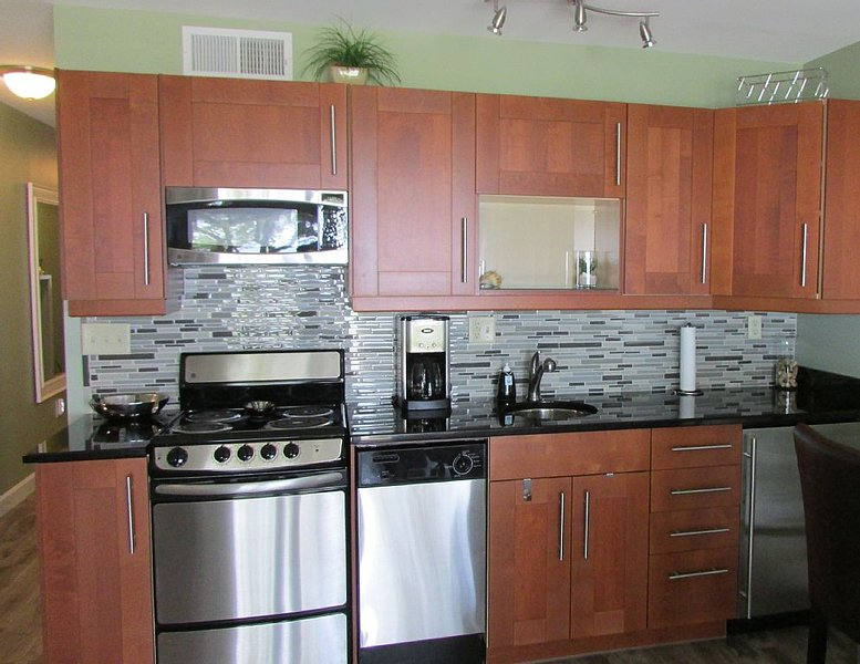 Full kitchen features stainless appliances & under counter refrigerator/freezer. - Waterfront Viila; Private Beach, Pier, Pool, Views - Hilton Head - rentals