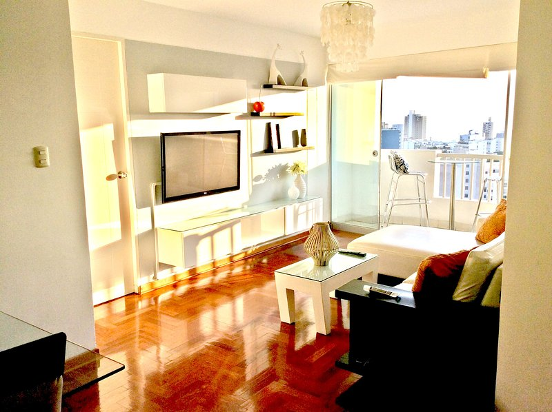 Bright and comfortable living room. - Beautiful high rise Apartment Building - Lima - rentals