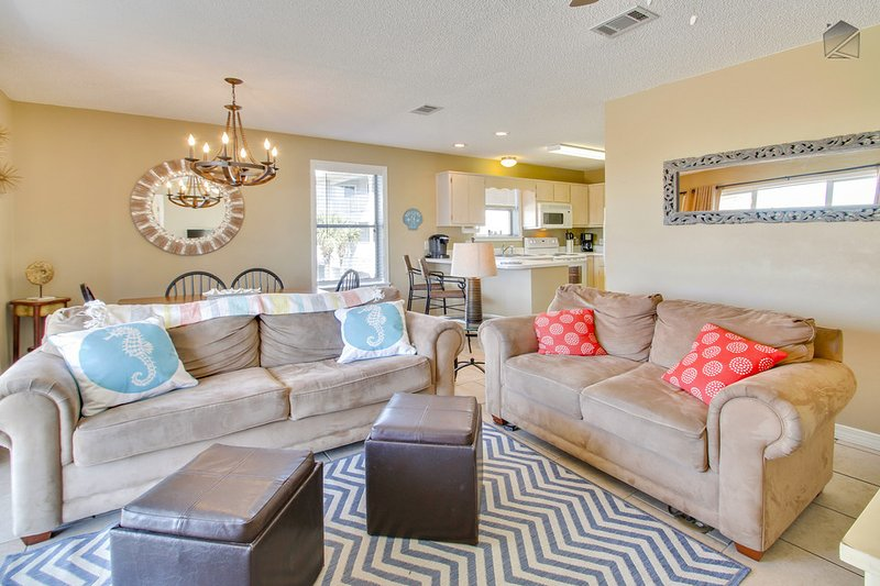The inside of the condo is light and bright, with plenty of seating to relax indoors - when you're not outside that is. - Condo with a peek of gulf views, perfect for families, two community pools and tennis courts - Sea Star - Santa Rosa Beach - rentals