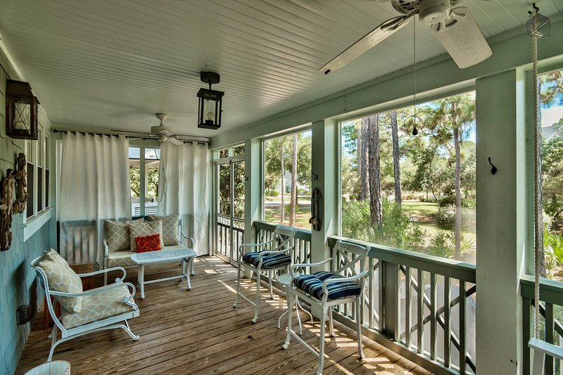 Enjoy the classic beach vibes on the screened in porch of your new favorite vacation home. - Stunning 3BR house in WaterSound, screened porch  - Captain's Cottage - Santa Rosa Beach - rentals