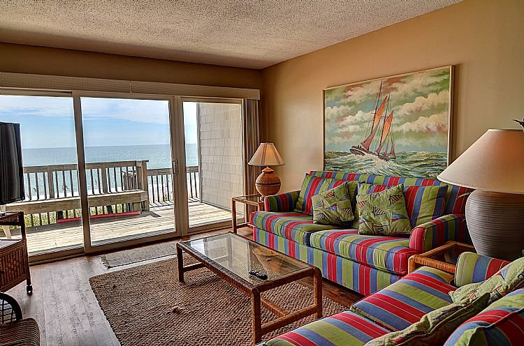 Living Room - Queen's Grant B-105 - Dynamic Oceanfront View, Pool, Hot Tub, Boat Ramp & Dock - Topsail Beach - rentals