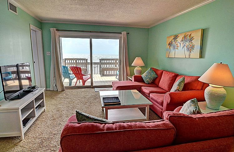 Living Room - Queen's Grant A-103 - Dynamic Oceanfront View, Pool, Hot Tub, Boat Ramp & Dock - Topsail Beach - rentals