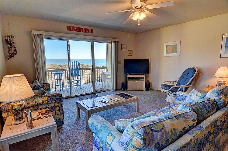 Living Room - Surf Condo 222 - Scenic Ocean View, Coastal Decor, Pool, Beach Access, Onsite Laundry - Surf City - rentals