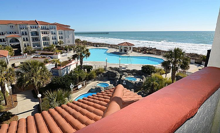 View of courtyard & beach from balcony - 310-A Villa Capriani - Gorgeous Views, Pools, Beach Access - North Topsail Beach - rentals