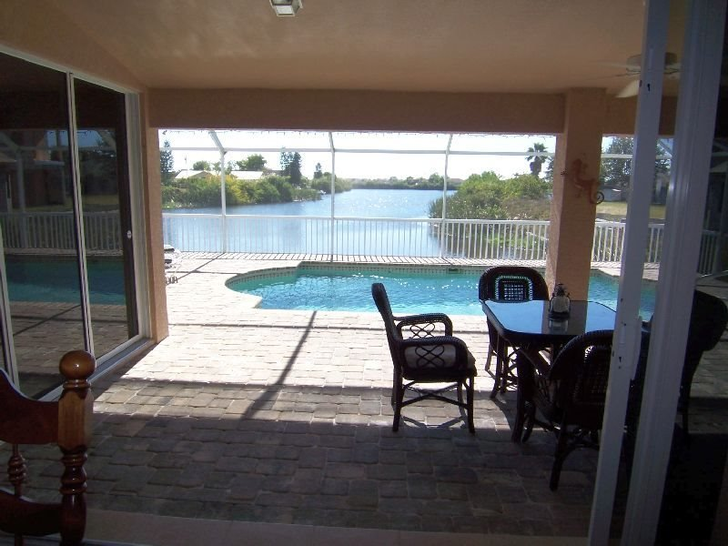 Sunny Haven (former Villa Lucy) - Cape Coral electric heated Pool Home with 3 bedroom/2 bathroom on a wide fresh water canal - Image 1 - Cape Coral - rentals