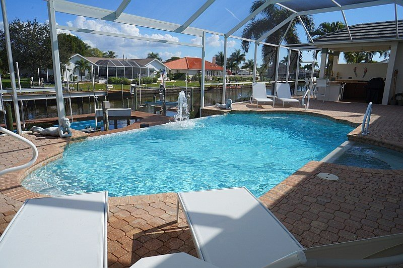 Villa Central - A Luxury Cape Coral 3b/3ba home w/electric heated pool/spa, gulf access canal, HSW Internet, Boat Dock, 2 Boat Lifts ( 20,000 lb and 4,000 lb ) - Image 1 - Cape Coral - rentals
