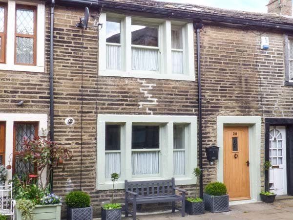 BAY COTTAGE, romantic pet-friendly character cottage, woodburners, WiFi, heart of Haworth Ref 919678 - Image 1 - Haworth - rentals