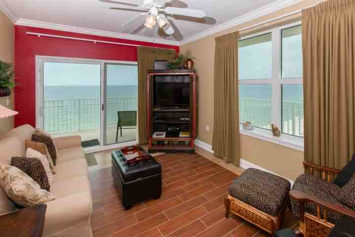 Enjoy your family gathering in this spacious living room that offers a breathtaking corner view of the Gulf! - Crystal Shores 1207 - Gulf Shores - rentals