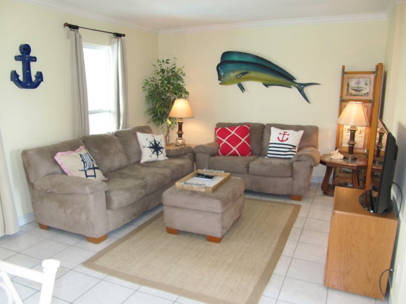 View of Living Room taken from Dining Room - *NEW LISTING*   Bay Tree Tennis & Yacht Club - Port Aransas - rentals
