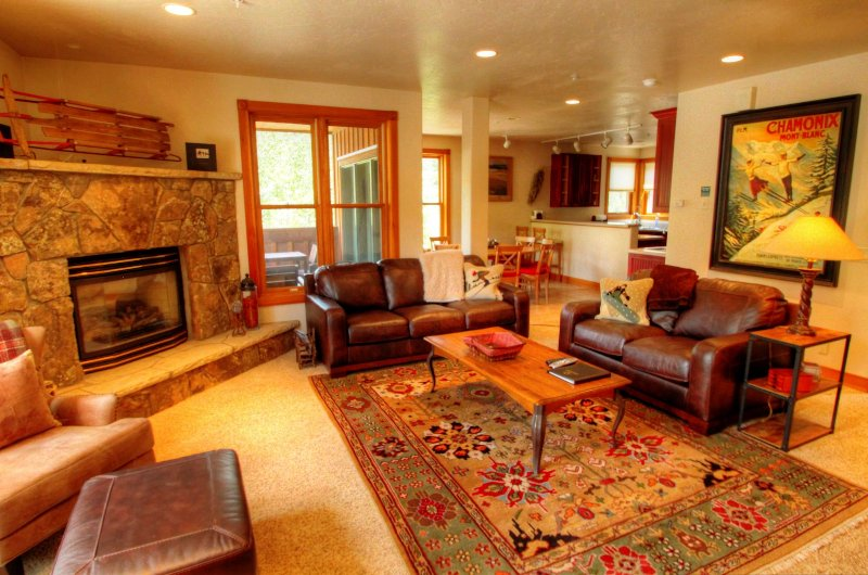 "SkyRun Property - ""202 Mill Creek"" - Living Room - Gather around the roaring gas fireplace in your spacious living room. - 202 Mill Creek - Keystone - rentals"