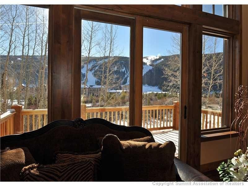 """SkyRun Property - """"Sanctuary 223"""" - Living room view - Spectacular views, 20 ft vaulted cielings, comfortable furniture and plenty of space by the fireplace and flat panel TV. - Sanctuary 223 - Keystone - rentals"""