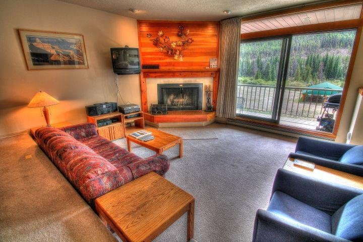 """SkyRun Property - """"1756 Montezuma"""" - Living Area - The living area for this property is much larger than most 1 bedroom condos and has a nice wood fireplace with free wood carried to your condo. - 1756 Montezuma - Keystone - rentals"""