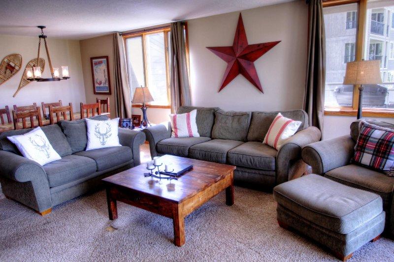 "SkyRun Property - ""2140 Pines"" - Living Room - The corner unit has lots of windows to enjoy the stunning view. - 2140 Pines - Keystone - rentals"